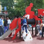 red horse riding themed proludic playground equipment slide tube and climbing area in use